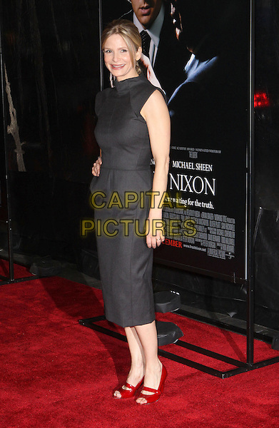 "KYRA SEDGWICK.At the premiere of ""Frost/Nixon"" held at the Ziegfeld Theater, New York, NY, USA, 17th November 2008..Frost Nixon full length grey gray dress red shoes open toe shiny RM Roland Mouret Mary janes .CAP/ADM/PZ.©Paul Zimmerman/Admedia/Capital Pictures"