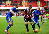 10th February 2018, Bramall Lane, Sheffield, England; EFL Championship football, Sheffield United versus Leeds United; John Fleck of Sheffield United and Adam Forshaw of Leeds United challenge for the ball watched by Ezgjan Alioski of Leeds United