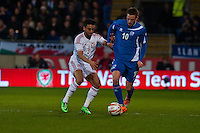 Wednesday 05 March 2014<br /> Pictured: (L-R) Neil Taylor takes on Gylfi Thor Sigurdson of Iceland<br /> Re: International friendly Wales v Iceland at the Cardiff City Stadium, Cardiff,Wales UK