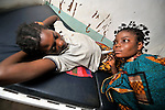 Pregnant Sheka Ehambi is examined by nurse Omba Dimoke in the United Methodist hospital in the Congolese village of Tunda.