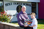 Holy Family School Launch 40 years booklet on Friday. Pictured First pupil 40 years ago Tony Griffin and son Evan Griffin,