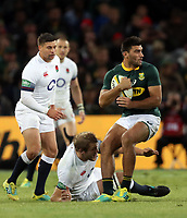 Joe Launchbury of England looks to tackle Damian de Allende of South Africa during the 2018 Castle Lager Incoming Series 2nd Test match between South Africa and England at the Toyota Stadium.Bloemfontein,South Africa. 16,06,2018 Photo by Steve Haag / stevehaagsports.com