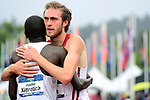 EUGENE, OR - JUNE 8: Justine Kiprotich of the Michigan State Spartans congratulates Oliver Hoare of the Wisconsin Badgers after his victory in the 1500 meter run during the Division I Men's Outdoor Track & Field Championship held at Hayward Field on June 8, 2018 in Eugene, Oregon. (Photo by Jamie Schwaberow/NCAA Photos via Getty Images)
