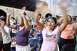 Women sing and wave their arms during an October 29, 2008, Catholic mass in the village of Santa Maria Manicera. The memorial mass was held on the eve of the tenth anniversary of Hurricane Mitch, which on October 30, 1998, devastated the area, causing a mudslide on the slopes of Nicaragua's Casita Volcano that swept through two villages below, killing more than 2,000 people. Many of the survivors were resettled in Santa Maria Manicera. A ceremony to remember the dead was held on the slopes of the mountain on the anniversary of the tragedy.