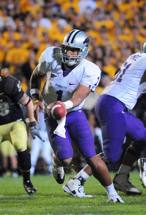 18 October 08: Kansas State quarterback Josh Freeman hands off on a rushing play against Colorado. The Colorado Buffaloes defeated the Kansas State Wildcats 14-13 at Folsom Field in Boulder, Colorado.