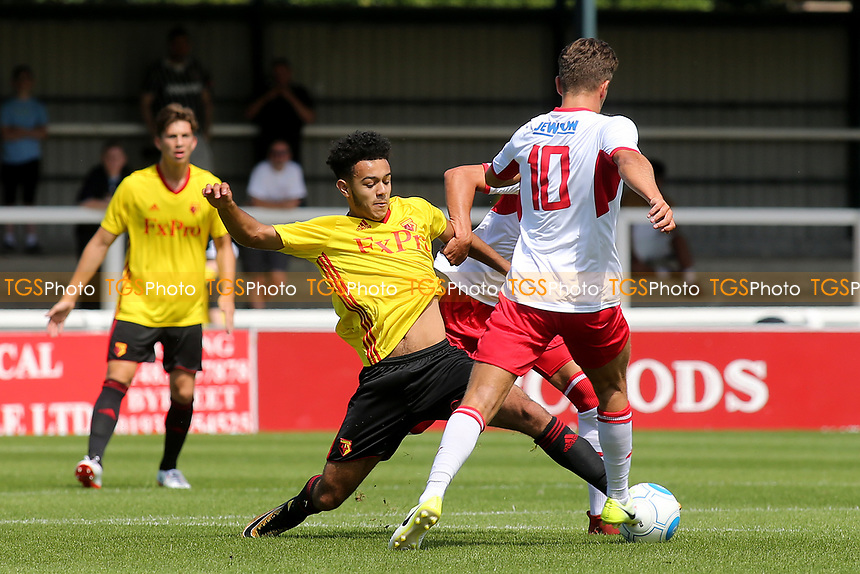 Dion Perriera of Watford tackles Charlie Carter of Woking during Woking vs Watford, Friendly Match Football at The Laithwaite Community Stadium on 8th July 2017