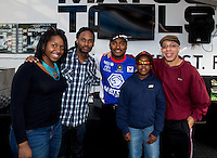 May 17, 2014; Commerce, GA, USA; Fans pose for a picture with NHRA top fuel dragster Antron Brown during qualifying for the Southern Nationals at Atlanta Dragway. Mandatory Credit: Mark J. Rebilas-USA TODAY Sports