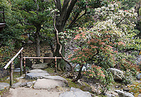 A stone path leads down to the lake in the Shosei-en garden
