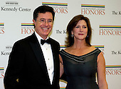 Stephen Colbert and his wife, Evelyn, arrive for the formal Artist's Dinner honoring the recipients of the 2012 Kennedy Center Honors hosted by United States Secretary of State Hillary Rodham Clinton at the U.S. Department of State in Washington, D.C. on Saturday, December 1, 2012. The 2012 honorees are Buddy Guy, actor Dustin Hoffman, late-night host David Letterman, dancer Natalia Makarova, and the British rock band Led Zeppelin (Robert Plant, Jimmy Page, and John Paul Jones)..Credit: Ron Sachs / CNP