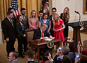 """United States President Donald J. Trump signs an executive order that will require colleges that receive federal research grant money to certify that they """"promote free inquiry"""" in the East Room of the White House in Washington, DC on Thursday, March 21, 2019.<br /> Credit: Ron Sachs / CNP"""