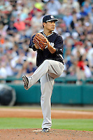 Starting pitcher Masahiro Tanaka (19) of the New York Yankees delivers a pitch in a Spring Training game against the Atlanta Braves on Wednesday, March 18, 2015, at Champion Stadium at the ESPN Wide World of Sports Complex in Lake Buena Vista, Florida. The Yankees won, 12-5. (Tom Priddy/Four Seam Images)
