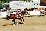 WALLY BAUMAN PHOTOGRAPHY .  Barrel racing at a Rodeo