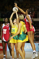16.11.2007 Australian Sharelle McMahon and Catherine Cox and England's Geva Mentor in action during the Australia v England match at the New World Netball World Champs held at Trusts Stadium Auckland New Zealand. Mandatory Photo Credit ©Michael Bradley.