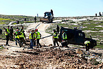 Israeli security forces secure the area as workers demolishing water network on a Palestinian land near the village of Yatta, south of the West Bank city of Hebron, February 13, 2019. Israeli authorities regularly demolish constructions and makeshift infrastructure of Palestinian residents who do not have needed permits to build or establish infrastructure in area C which is under the Israeli control in the occupied West Bank. Photo by Wisam Hashlamoun