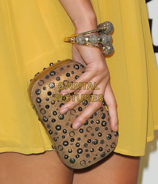 Nicole Richie's clutch bag .attends The 21st Annual Environmental Media Awards held at at Warner Bros. Studios in Burbank, California, USA, October 15th 2011..detail hand bronze studded studs gold bracelet .CAP/RKE/DVS.©DVS/RockinExposures/Capital Pictures.