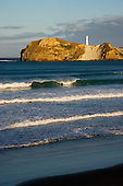 Late evening light on beach and lighthouse at Castlepoint