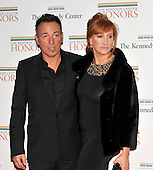 Washington, DC - December 5, 2009 -- Bruce Springsteen, one of the 2009 Kennedy Center honorees, left, and his wife, Patti Scialfa Springsteen, right, arrive for the formal Artist's Dinner at the United States Department of State in Washington, D.C. on Saturday, December 5, 2009..Credit: Ron Sachs / CNP.(RESTRICTION: NO New York or New Jersey Newspapers or newspapers within a 75 mile radius of New York City)