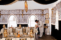 One of the waiters at the Ubari Magic Lodge in Lybia prepares the large restaurant tent for the evening meal