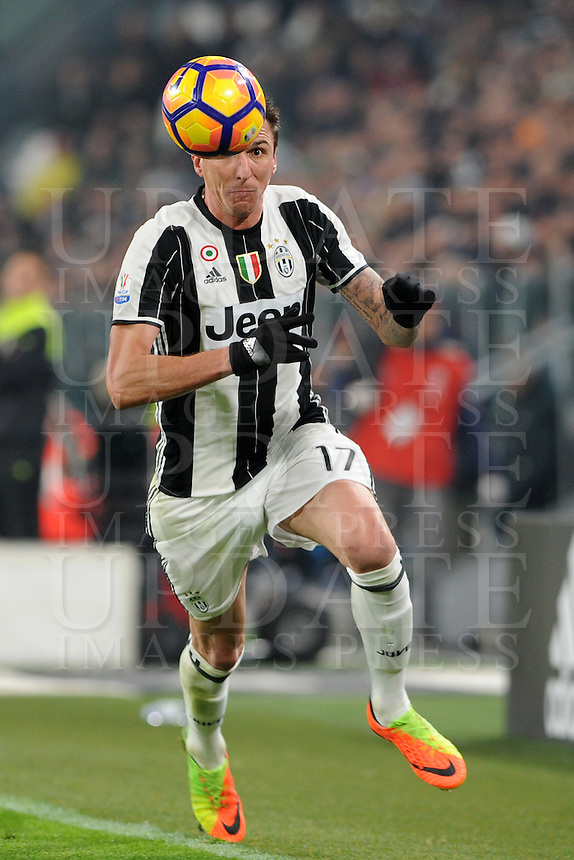 Calcio, semifinale di andata di Tim Cup: Juventus vs Napoli. Torino, Juventus Stadium, 28 febbraio 2017.<br /> Juventus' Mario Mandzukic in action during the Italian Cup semifinal first leg football match between Juventus and Napoli at Turin's Juventus stadium, 28 February 2017.<br /> UPDATE IMAGES PRESS/Manuela Viganti