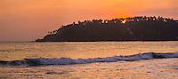 Panoramic photo of Mirissa Beach at sunset, South Coast of Sri Lanka, Southern Province, Asia. This is a panoramic photo of Mirissa Beach at sunset, Sri Lanka, Asia. Mirissa Beach, a popular palm tree lined sandy beach in the Southern Province on the South Coast of Sri Lanka is often blessed with a beautiful sunset.