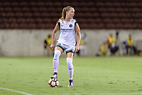 Houston, TX - Saturday July 08, 2017: Celeste Boureille looks to pass the ball during a regular season National Women's Soccer League (NWSL) match between the Houston Dash and the Portland Thorns FC at BBVA Compass Stadium.