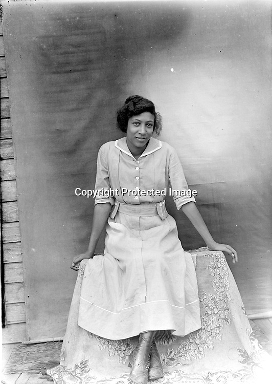 MANILLA JEWETT IN SHIRTDRESS. The continued popularity of the shirtdress gives this young woman a modern air, as does her direct and confident gaze.<br />