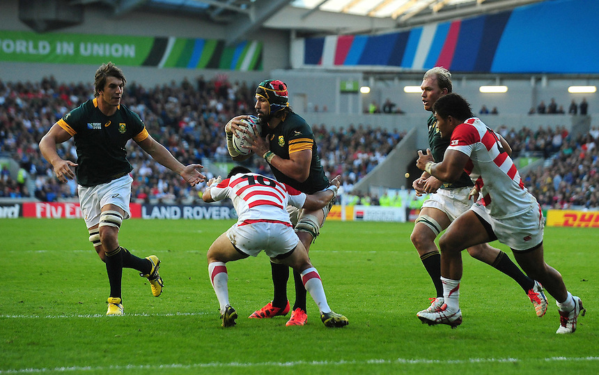 South Africa's Victor Matfield is tackled by Japan's Kosei Ono<br /> <br /> Photographer Kevin Barnes/CameraSport<br /> <br /> Rugby Union - 2015 Rugby World Cup - Japan v South Africa - Saturday 19th September 2015 - The American Express Community Stadium - Falmer - Brighton<br /> <br /> &copy; CameraSport - 43 Linden Ave. Countesthorpe. Leicester. England. LE8 5PG - Tel: +44 (0) 116 277 4147 - admin@camerasport.com - www.camerasport.com