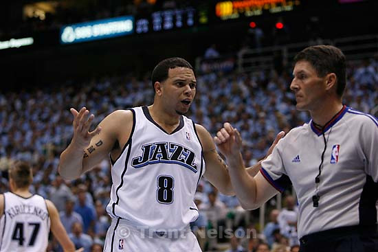 Salt Lake City - Utah Jazz guard Deron Williams (8) complains to official Scott Foster after Williams was called for his fourth foul. Utah Jazz vs. Golden State Warriors, NBA Playoffs basketball, second round, Game Two, at EnergySolutions Arena.