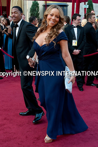 """Mariah Carey.OSCARS 2010 RED CARPET ARRIVALS.The 82nd Academy Awards  arrivals took place under a transparent tent to keep the red carpet dry from the pending rain_ Kodak Theatre, Hollywood, Los Angeles_07/03/2009.Mandatory Photo Credit: ©Dias/Newspix International..**ALL FEES PAYABLE TO: """"NEWSPIX INTERNATIONAL""""**..PHOTO CREDIT MANDATORY!!: NEWSPIX INTERNATIONAL(Failure to credit will incur a surcharge of 100% of reproduction fees)..IMMEDIATE CONFIRMATION OF USAGE REQUIRED:.Newspix International, 31 Chinnery Hill, Bishop's Stortford, ENGLAND CM23 3PS.Tel:+441279 324672  ; Fax: +441279656877.Mobile:  0777568 1153.e-mail: info@newspixinternational.co.uk"""