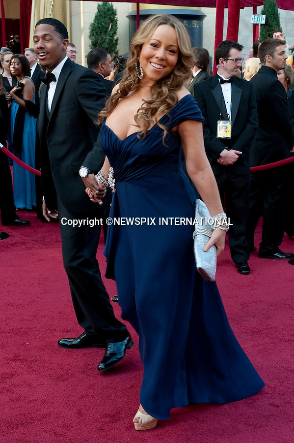 "Mariah Carey.OSCARS 2010 RED CARPET ARRIVALS.The 82nd Academy Awards  arrivals took place under a transparent tent to keep the red carpet dry from the pending rain_ Kodak Theatre, Hollywood, Los Angeles_07/03/2009.Mandatory Photo Credit: ©Dias/Newspix International..**ALL FEES PAYABLE TO: ""NEWSPIX INTERNATIONAL""**..PHOTO CREDIT MANDATORY!!: NEWSPIX INTERNATIONAL(Failure to credit will incur a surcharge of 100% of reproduction fees)..IMMEDIATE CONFIRMATION OF USAGE REQUIRED:.Newspix International, 31 Chinnery Hill, Bishop's Stortford, ENGLAND CM23 3PS.Tel:+441279 324672  ; Fax: +441279656877.Mobile:  0777568 1153.e-mail: info@newspixinternational.co.uk"