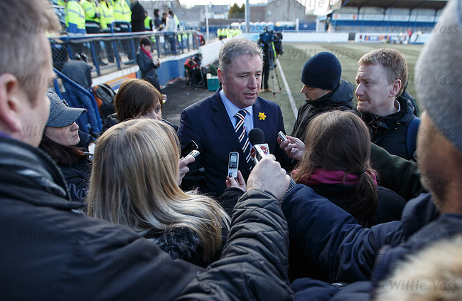 Ally McCoist grilled by the print journalists on the pitch after the game