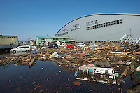 A factory close to Sendai airport full of mud and rubbish after the earthquake and tsunami that swept through the area, Sendai, Japan.  The earthquake, tsunami and nuclear fallout has meant that the March 11th quake was the costliest natural disaster known to man..13 Mar 2011.