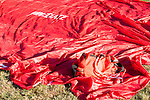 A red tarp with the word Immediate on it used at a Mass Casualty incident with a EMS bag