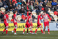 Josh Windass of Accrington Stanley (far right) celebrates scoring his side's second during the Sky Bet League 2 match between Newport County and Accrington Stanley at Rodney Parade, Newport, Wales on 28 March 2016. Photo by Mark  Hawkins.