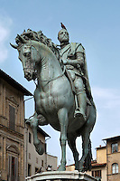 Low angle view of bronze equestrian statue of Cosimo I de' Medici (12 June, 1519 - 21 April 1574), Duke of Florence and first Grand Duke of Tuscany, by Giambologna, born as Jean Boulogne, incorrectly known as Giovanni da Bologna and Giovanni Bologna (1529 - 13 August 1608), erected in 1598, Piazza della Signoria, Florence, Italy, pictured on 9 June, 2007 in the afternoon, with a pigeon perched on the Duke's head. Picture by Manuel Cohen