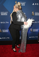 WEST HOLLYWOOD, CA - FEBRUARY 7: Meghan Trainor and Ashlee Simpson at the Delta Air Line 2019 GRAMMY Party at Mondrian LA in West Hollywood, California on February 7, 2019.   <br /> CAP/MPI/SAD<br /> ©SAD/MPI/Capital Pictures