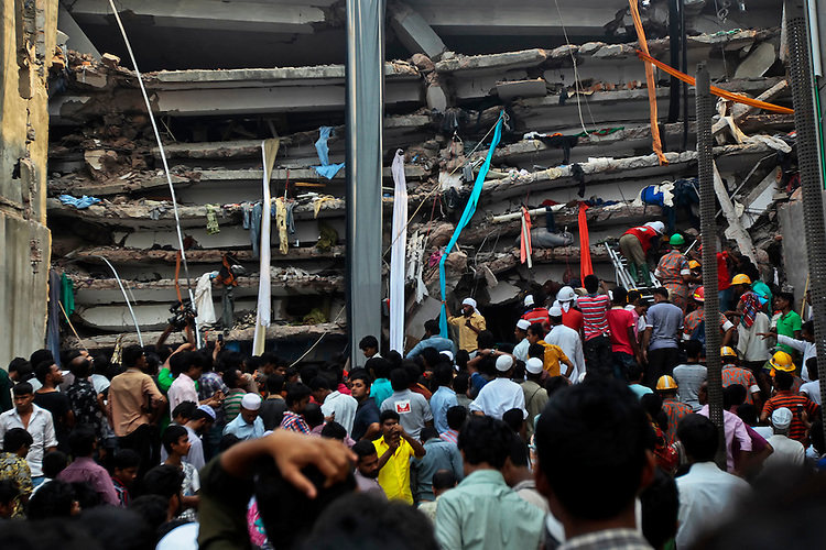 Rescuers look for survivors in the debris of a building that collapsed in Savar, near Dhaka, Bangladesh, Wednesday, April 24, 2013.