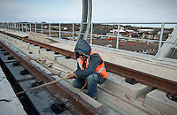Dallas Area Rapid Transit worker Edgar Godinez (cq) on a new light-rail transit stop for the new Green Line in Carrollton, Texas, USA, Thursday, Dec., 3, 2009. The City of Dallas hopes plans to open the new line in 2010...MATT NAGER/ BLOOMBERG NEWS