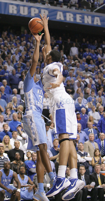 UK freshman forward Anthony Davis blocks North Carolina forward John Henson final shot to win the game during the second half of UK's home game against North Carolina at Rupp Arena in Lexington, Ky., Dec. 1, 2011. UK beat North Carolina 73-72. Photo by Brandon Goodwin | Staff
