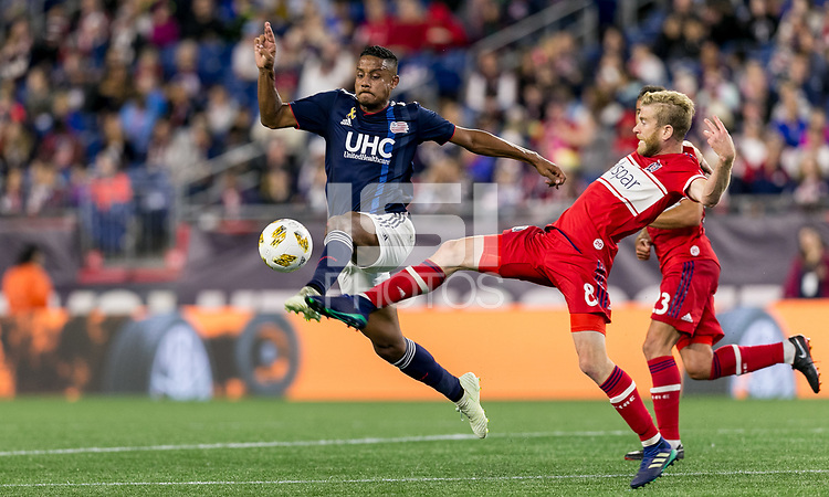 Foxborough, Massachusetts - September 22, 2018: First half action. In a Major League Soccer (MLS) match, New England Revolution (blue/white) vs Chicago Fire (red), at Gillette Stadium.