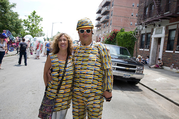 A couple dressed in costumes made out of MetroCards during Coney Island's 2011 Mermaid Parade, a celebration of the sand, the sea, the salt air, and the beginning of summer, as well as the history and mythology of Coney Island, Coney Island pride, and artistic self-expression, held at Coney Island in Brooklyn, New York, 18 June 2011.