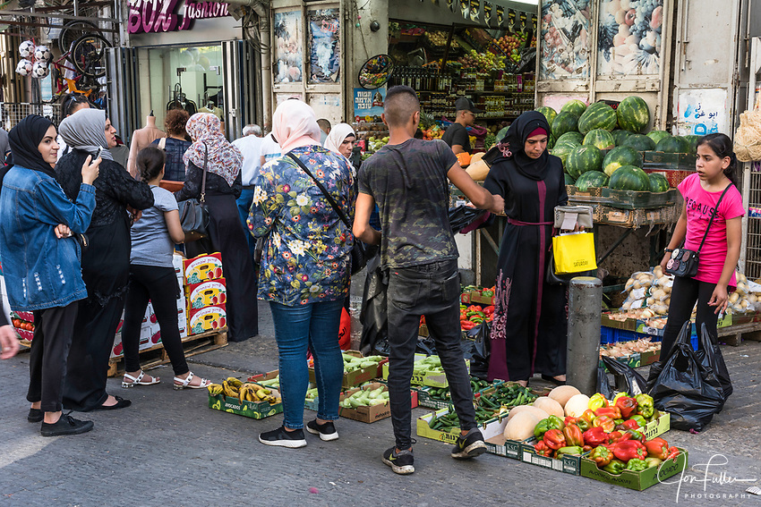 Palestinian Arab women wearing the traditional Muslim hajibs or head scarfs shopping for fresh produce on Nablus Street by the Damascus Gate in East Jerusalem.