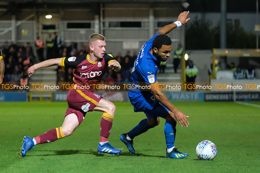 Andy Barcham of AFC Wimbledon and Lewis O'Brien of Bradford City during AFC Wimbledon vs Bradford City, Sky Bet EFL League 1 Football at the Cherry Red Records Stadium on 2nd October 2018