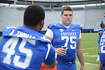 Lexington native, Zach West, stares down fellow teammate Pancho Thomas at UK Football Media Day on Friday, August 3, 2012. Photo by Mike Weaver| Staff