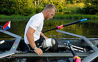 Former Marine sergeant Rob Jones uses a special gasket around his stump to secure himself into the double scull boat Wednesday July, 25, 2012 during training on the Rivanna River in Charlottesville, VA. Former Marine sergeant Jones, who lost both legs during an IED explosion in Afghanistan, will compete as a rower at the 2012 Paralympics in London, England. Rowing will make its appearance at the London Paralympic Games for only the second time, after its introduction at the Beijing 2008 Games. Photo/Andrew Shurtleff