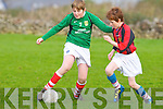 Fenit Samphires Michael Kirby and St Bernard's Keith O'Connor in action at Fenit on Saturday.