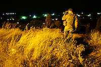 "Azov battalion commander ""Kirt"" scans the horizon with a night vision scope on the edge of Mariupol, Ukraine. September 2014."