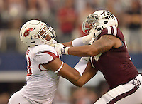 STAFF PHOTO BEN GOFF  @NWABenGoff -- 09/27/14 Arkansas defensive end Deatrich Wise, Jr., left, blocks Texas A&M left tackle Cedric Ogbuehi during the second quarter of the game against Texas A&M in the Southwest Classic in AT&T Stadium in Arlington, Texas on Saturday September 27, 2014.