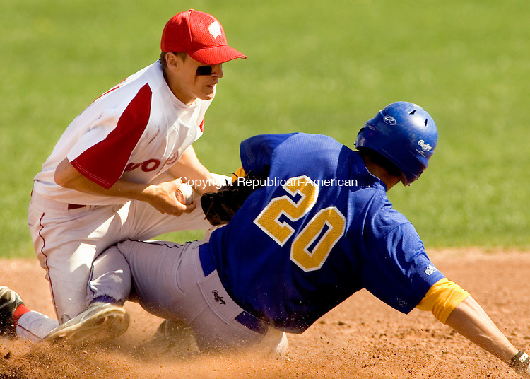 WOLCOTT, CT--02 MAY 2007--050207JS07- Seymour's Chris Renzoni (20) is caught trying to steal second as Wolcott's Ryan Pelletier (4) tags him out during their game Wednesday at the BAW field in Wolcott. <br /> Jim Shannon/Republican-American