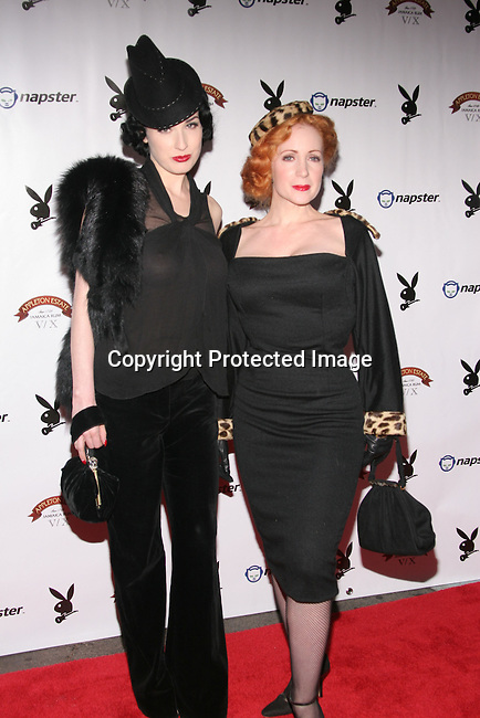 Dita Von Teese &amp; Catherine D'Lish<br />Rock Out in Honor of the Artists of the 2004 Music Poll<br />Prey<br />Los Angeles, CA, USA.<br />November 11, 2004<br />Photo By Celebrityvibe.com/Photovibe.com, <br />New York, USA, Phone 212 410 5354, <br />email:sales@celebrityvibe.com